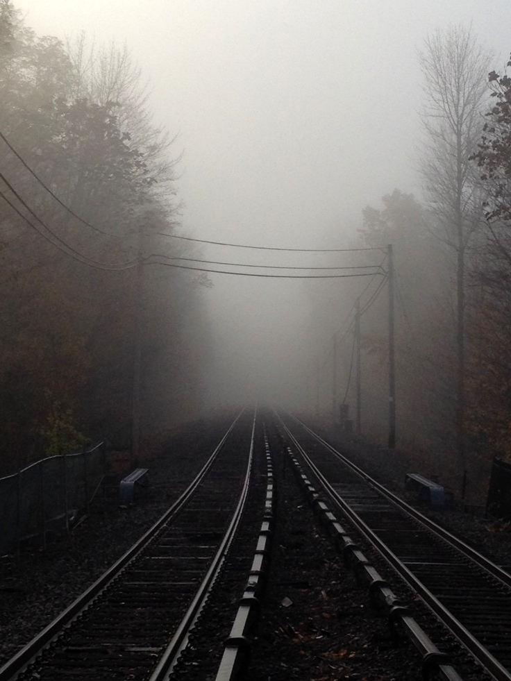 About the same time at the train station, fog is creeping in on the track.